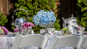 Garden Party Ideas - table set up with flowers, shining sterling silver and mismatched tea cups