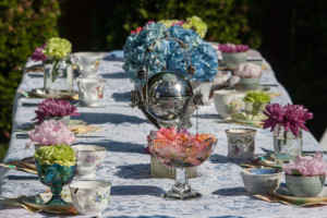 Garden Party Ideas - the floral table with colourful flower blooms, teacups and saucers