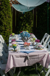 Garden Party Ideas - floral table and hanging umbrellas