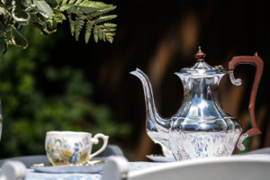 Garden Party Ideas - mismatched tea cups and antique silver tea pot