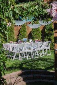 Garden Party Ideas - giant flowers, hanging umbrellas and a floral table.