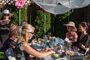 Garden Party Ideas - scones and tea around a table while listening to the Announcement of Murder for the murder mystery party